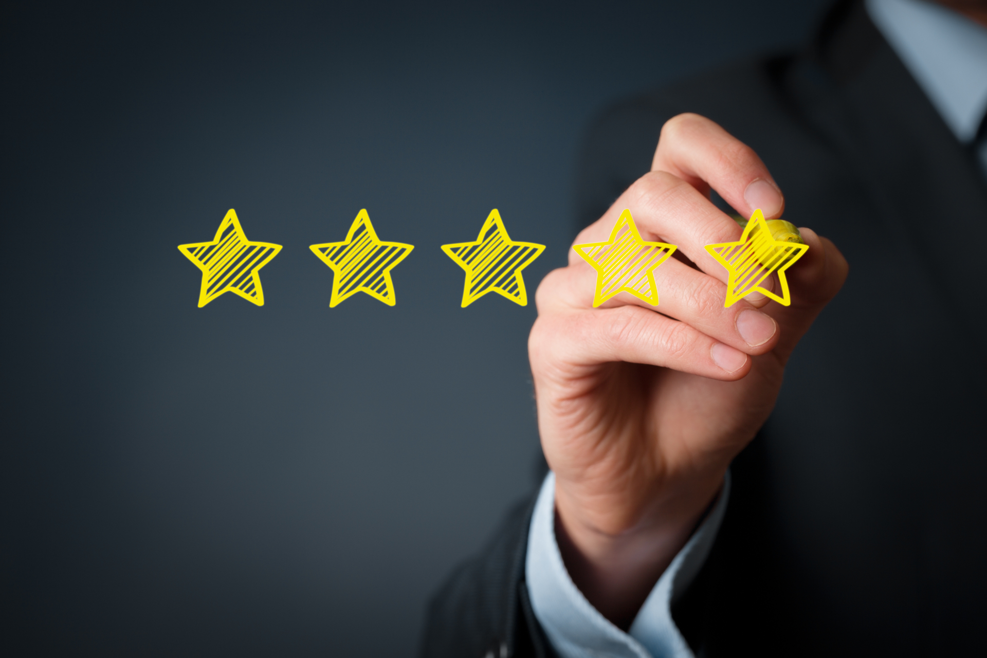 Businessman draw five yellow star to increase rating of his company.