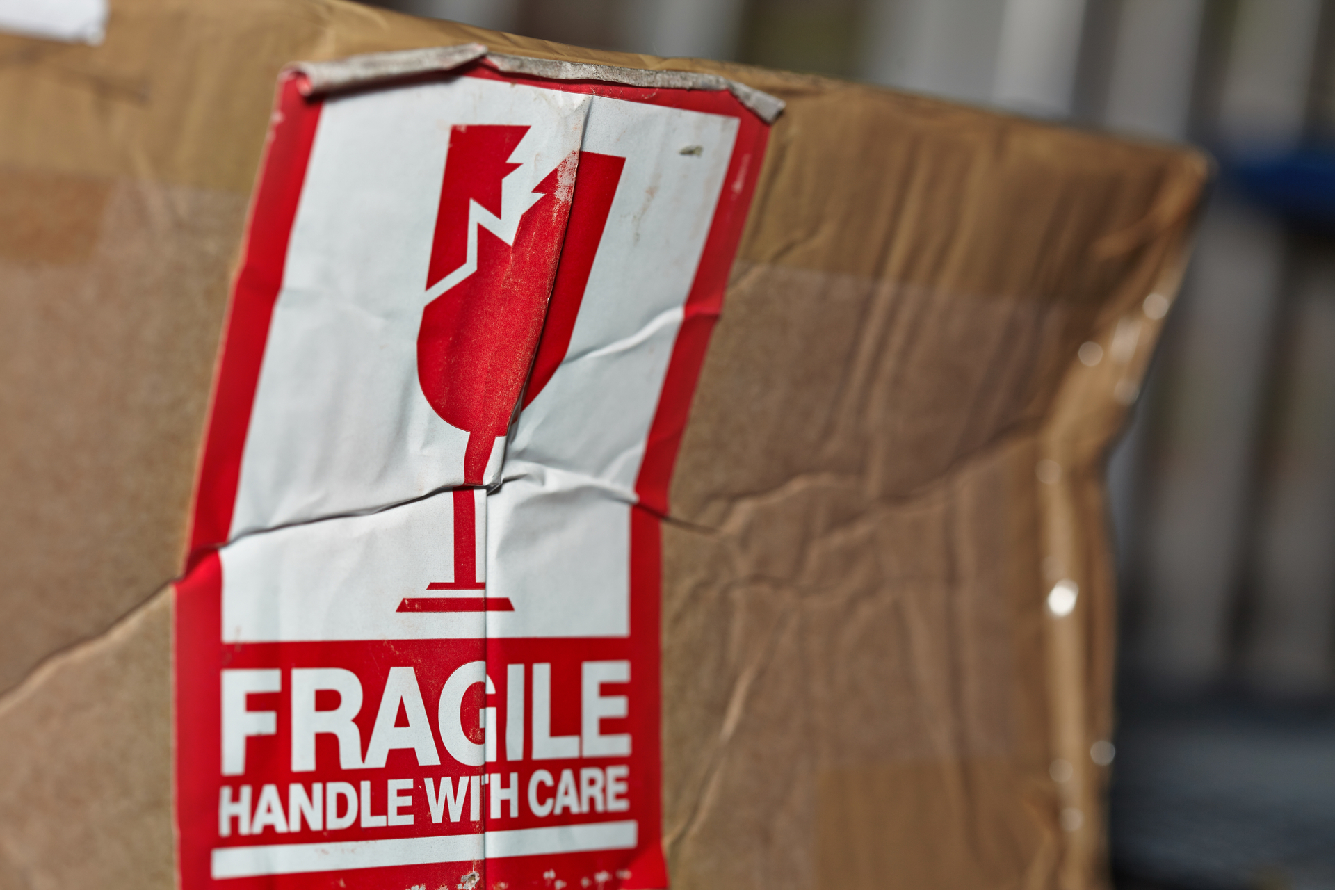 Fragile Handle With Care Sign On A Damaged Package